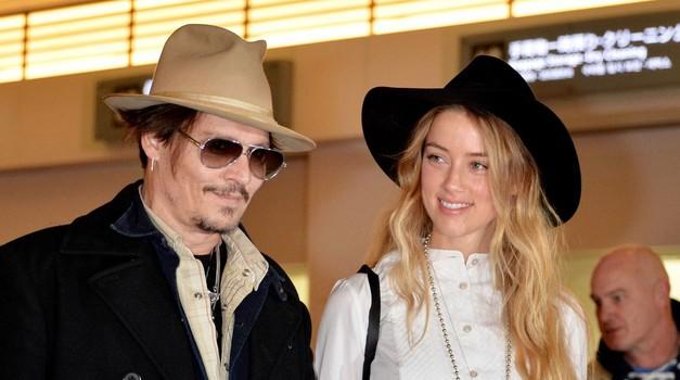 Na dan prišle podrobnosti s poročne zabave Johnnyja in Amber (foto: Profimedia)