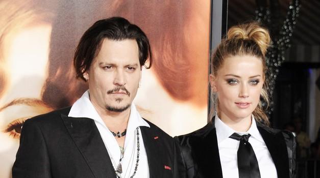 Johnny in Amber: Kaj se v resnici skriva za hitrim sporazumom? (foto: Profimedia)